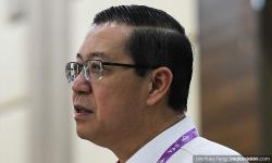 Guan Eng reveals photos of suspect's wife with BN leaders