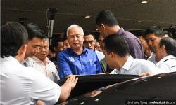 Besieged Najib leaves for Pekan