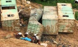 Father pulls out son's body from Penang landslide