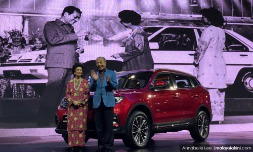 Proton, Dr M, 33 years later