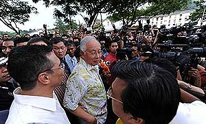 PM Najib Razak speaks to the press outside the gutted administrative block of Metro Tabernacle church 2