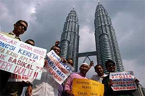 petrol price hike protest 2 100306 klcc