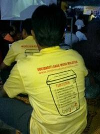 penang bersih 3.0 rally participant with yellow shirt