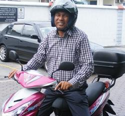 ex-igp musa hassan on a motorbike 2